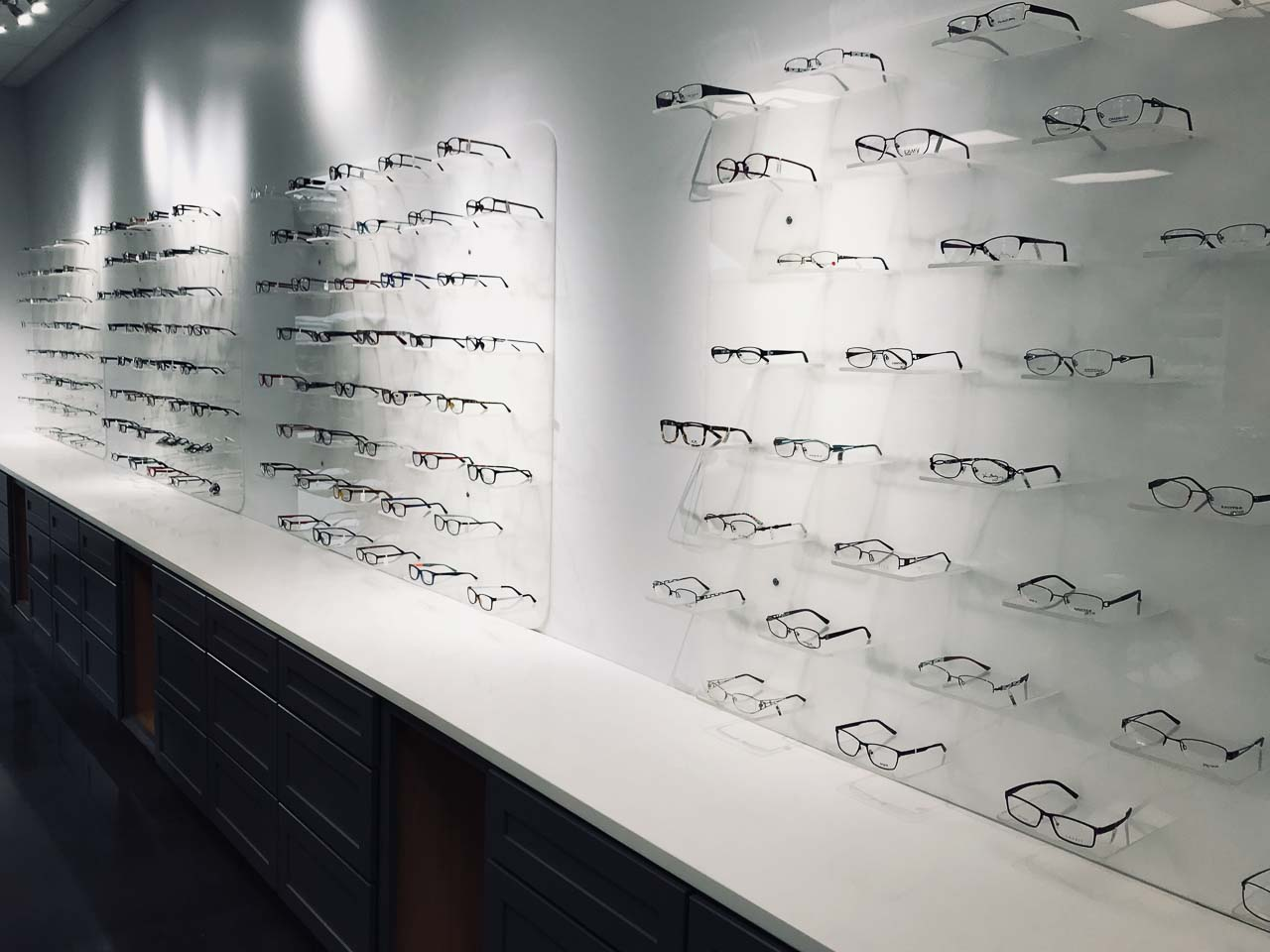 One of the many walls of eyeglasses available at Looking Glass Vision